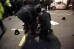 A deminstrator beaten by the police